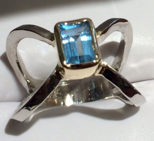 Blue Topaz X Ring with white gold & yellow gold bezel