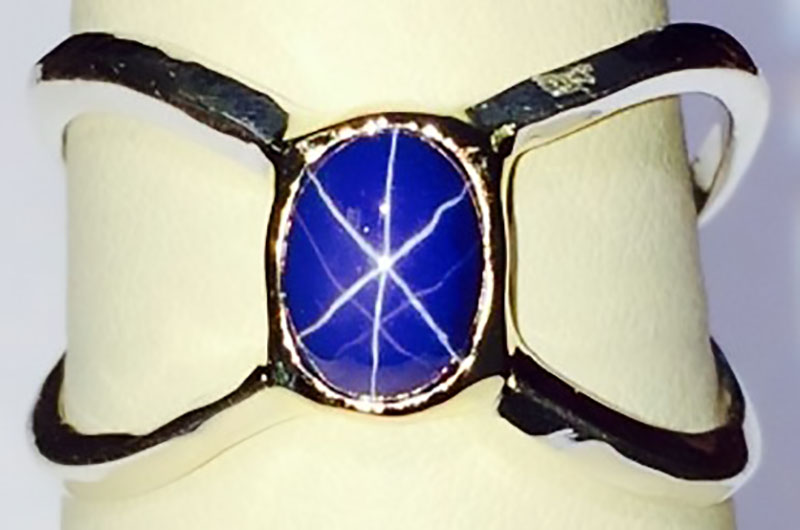 White Gold Star Sapphire ring with yellow gold bezel